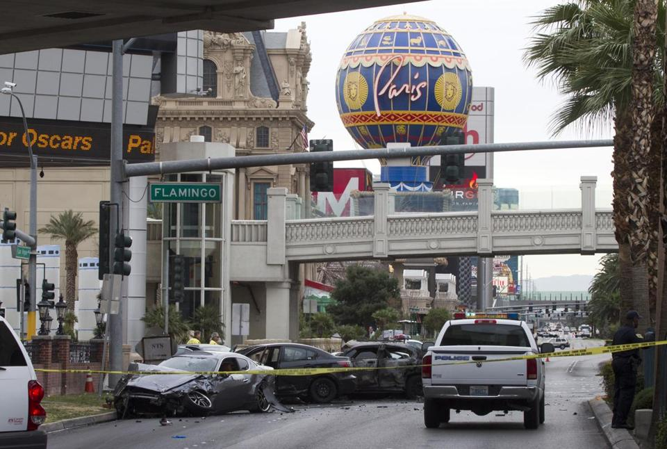 Police roped off the scene of a shooting and multi-vehicle crash on the Las Vegas Strip.