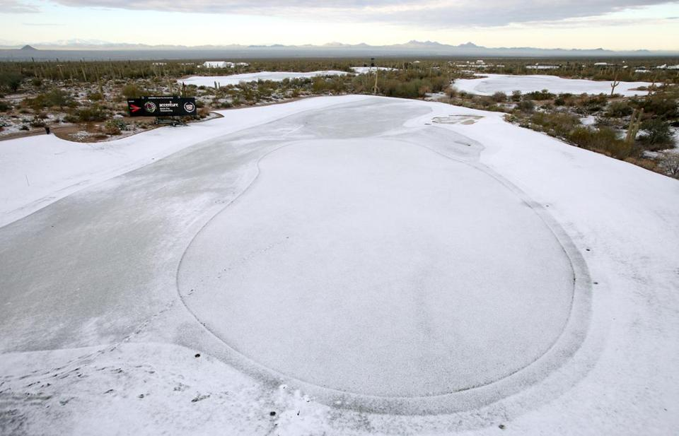Snow coated the ninth green at the site of the Match Play Championships on Thursday.