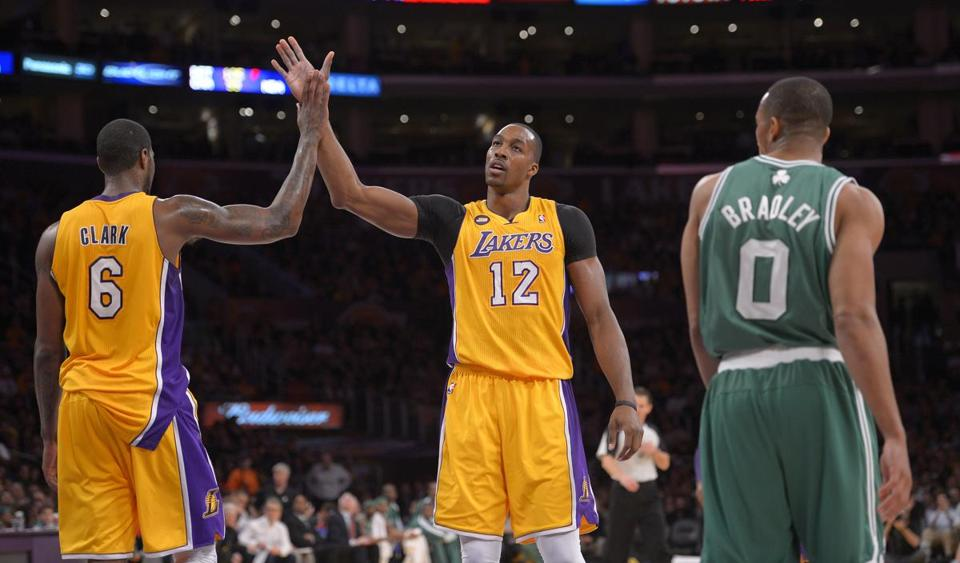Dwight Howard, center, and the Lakers beat the Celtics on Wednesday.