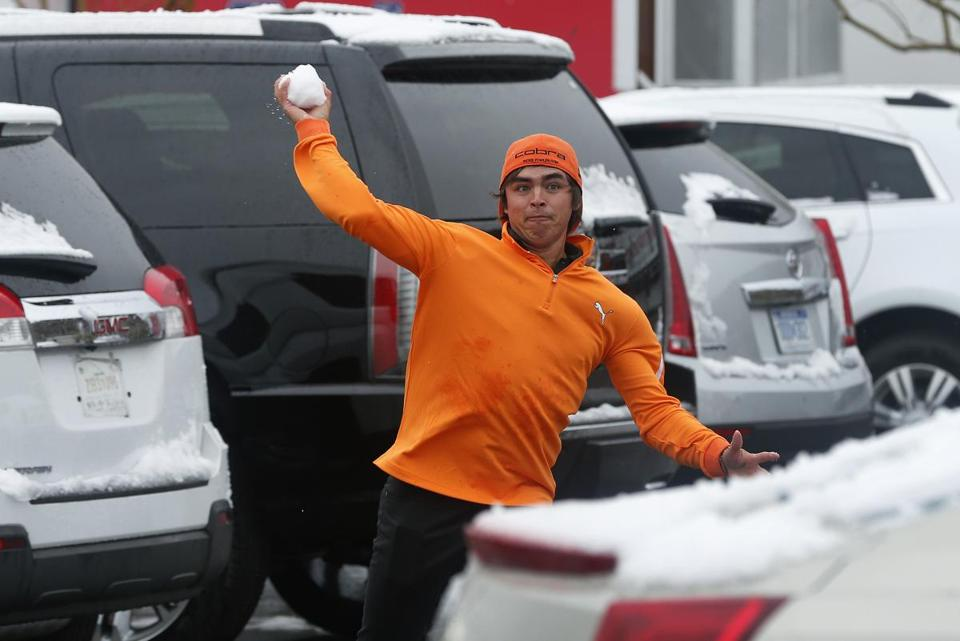 Rickie Fowler worked on a different short game during a weather delay — tossing snowballs at fellow PGA players.
