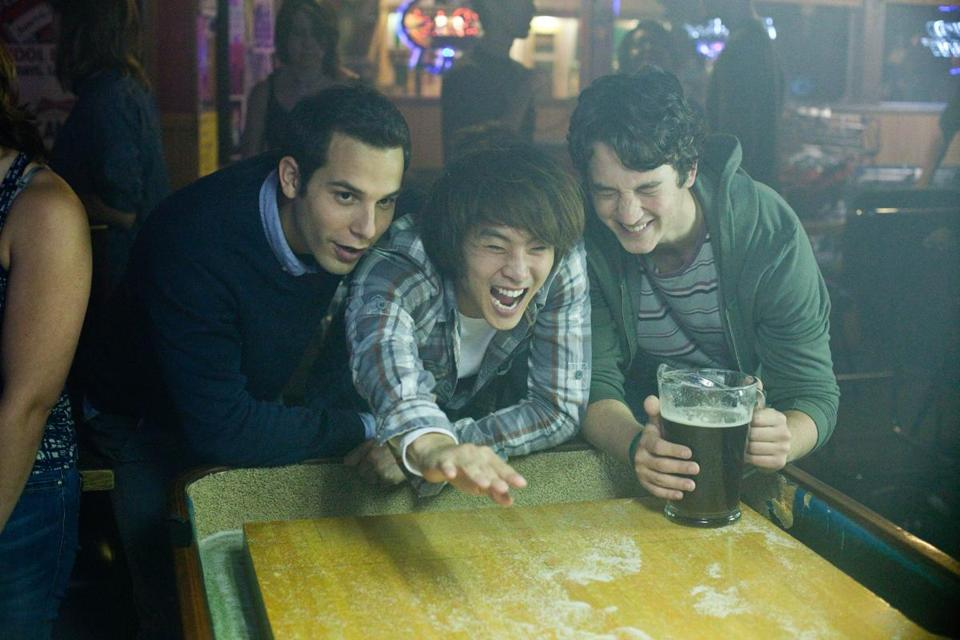 "From left: Skylar Astin, Justin Chon, and Myles Teller star as friends celebrating a birthday in ""21 & Over.''"