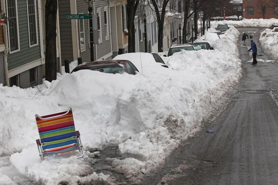 City dwellers shoveled out buried cars, often leaving chairs to save their spaces, after the blizzard earlier this month.