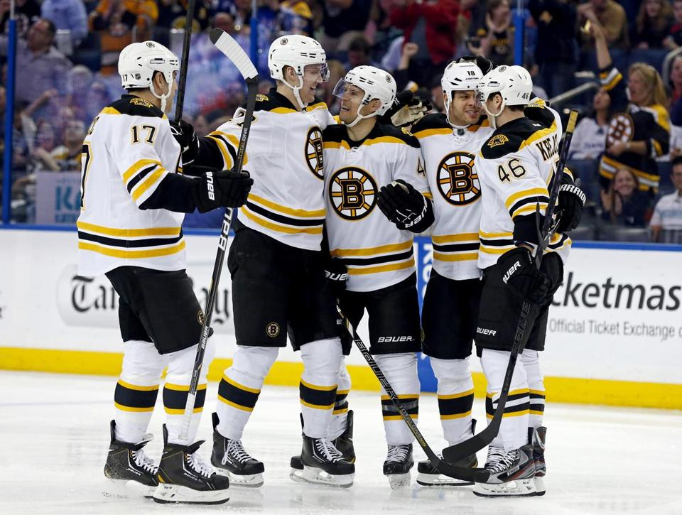 Milan Lucic, Dougie Hamilton, Dennis Seidenberg,  Nathan Horton and David Krejci celebrated a goal against the Tampa Bay Lightning.
