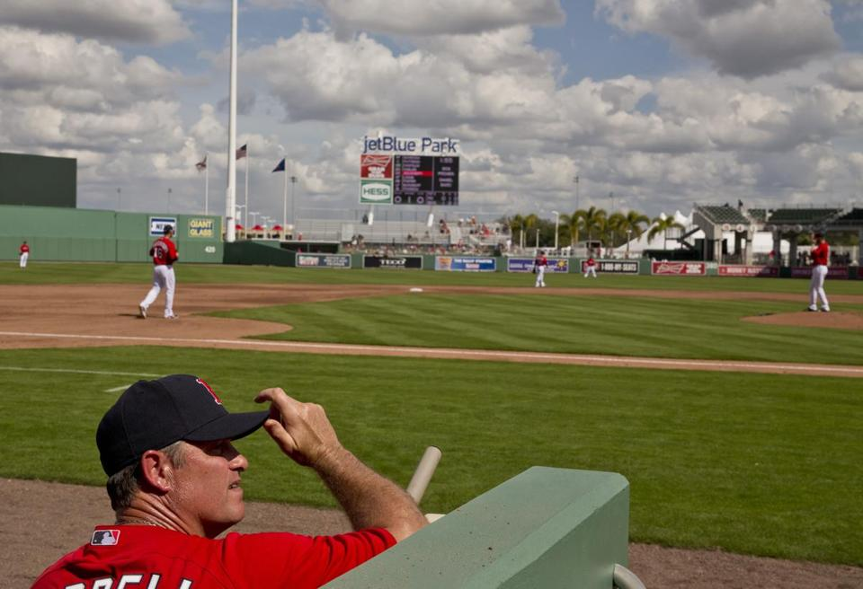 Red Sox manager John Farrell watched as his team took the field for the exhibition opener against Northeastern.