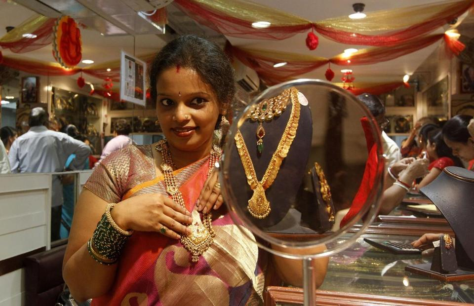 The gold items in a Mumbai, India, shop, got a shopper's attention. India is the world's biggest buyer of gold.