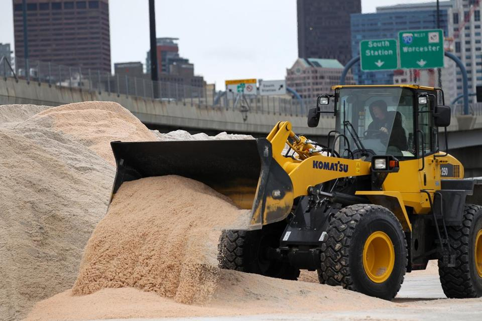 City workers prepared for a storm Saturday that was expected to bring 1 or 2 inches of snow to Boston.
