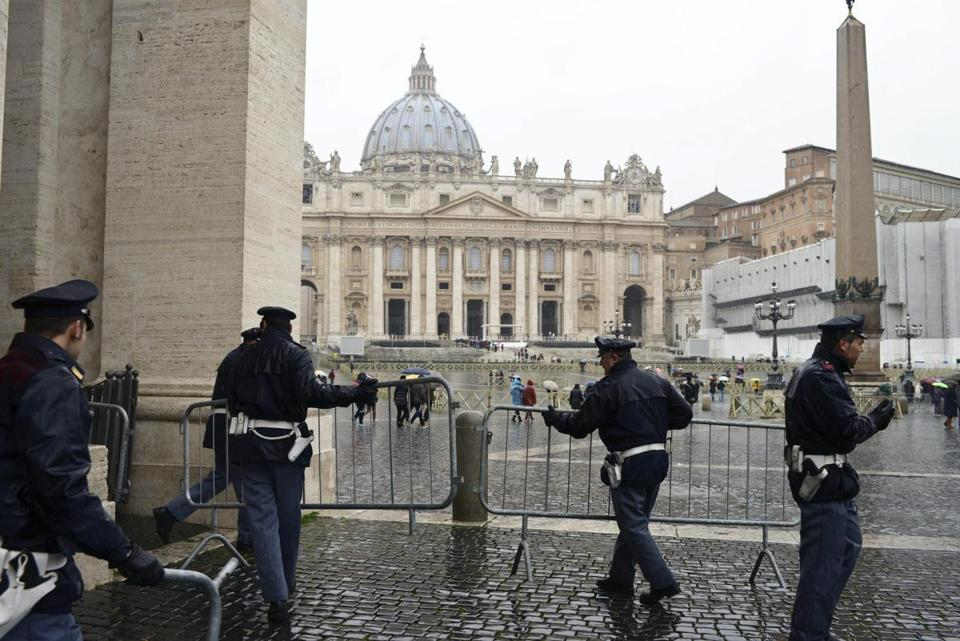 Police set up barriers on Saturday ahead of Benedict XVI's final Sunday service as pope.