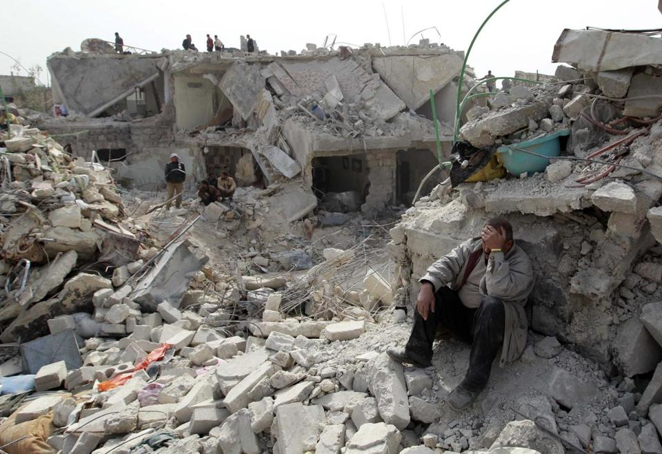 On Saturday, Aleppo residents examined the rubble from a Scud missile attack by the Syrian government the day before.