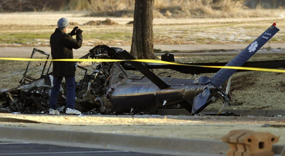 An FAA official examined the site of a medical helicopter crash where 2 people died and another person was hurt.