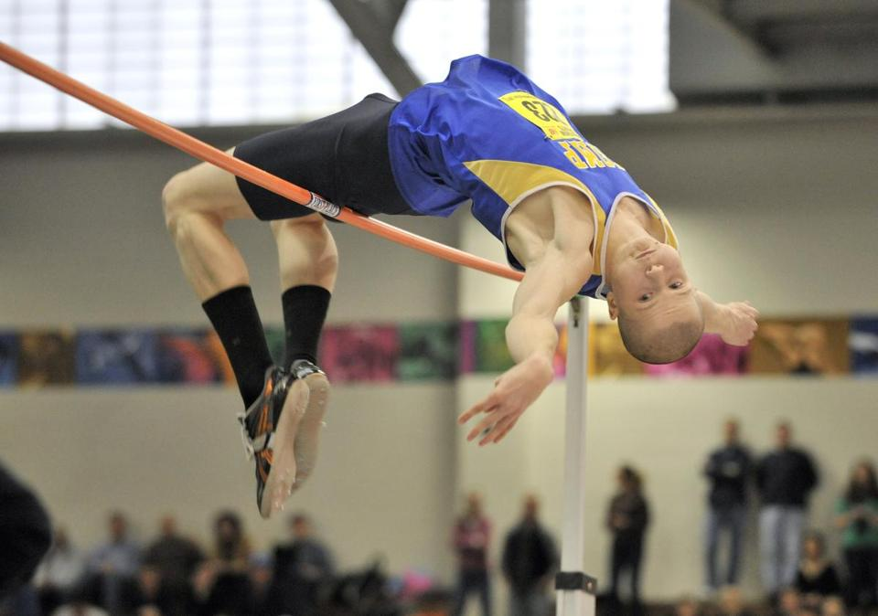 Chicopee's Alex Niemiec clears 6 feet 8 inches for second in the high jump; he also set a record in the long jump.
