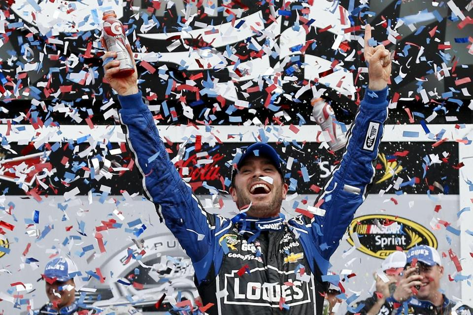 Jimmie Johnson, driver of the #48 Lowe's Chevrolet, celebrated after winning the NASCAR Sprint Cup Series Daytona 500 at Daytona International Speedway on Sunday.