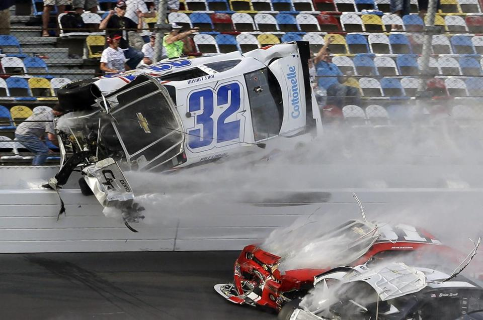 Kyle Larson (32) went airborne and into the catch fence during a multi-car crash during the final lap of the NASCAR Nationwide Series auto race at Daytona International Speedway on Saturday.