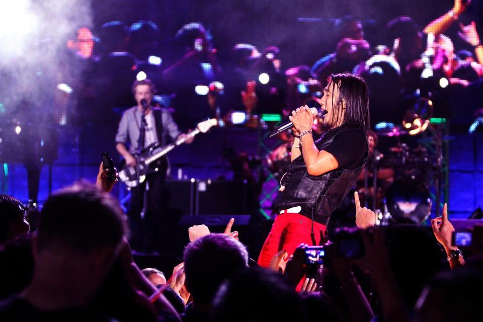 "Arnel Pineda performs with Journey in a scene from the documentary ""Don't Stop Believin': Everyman's Journey."""