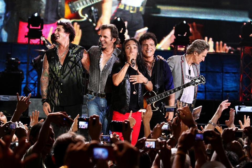 "The band Journey performing in the Philippines, the homeland of the band's new frontman Arnel Pineda (center). ""Don't Stop Believin': Everyman's Journey"" is director Ramona S. Diaz's documentary about the singer's personal journey. The film opens at the Coolidge Corner Theatre this week."