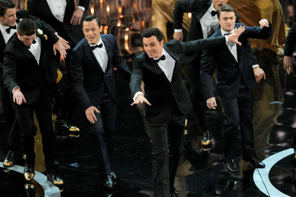 From left: actors Joseph Gordon-Levitt, Seth MacFarlane, and Daniel Radcliffe perform during the Oscars telecast.