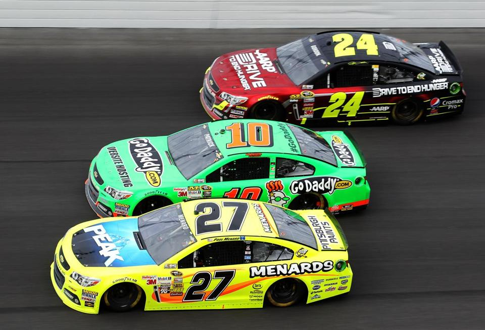 The cars of Paul Menard (27) and Jeff Gordon (24) surround that of Danica Patrick at the Daytona 500.