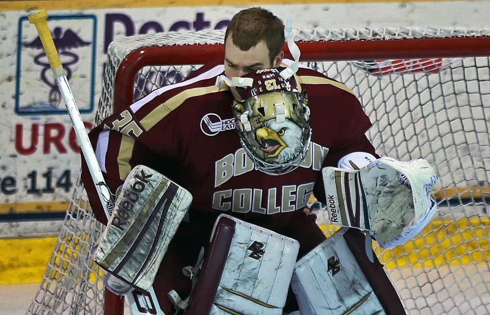 Boston College goalie Parker Milner lost his mask after stopping a first period shot.