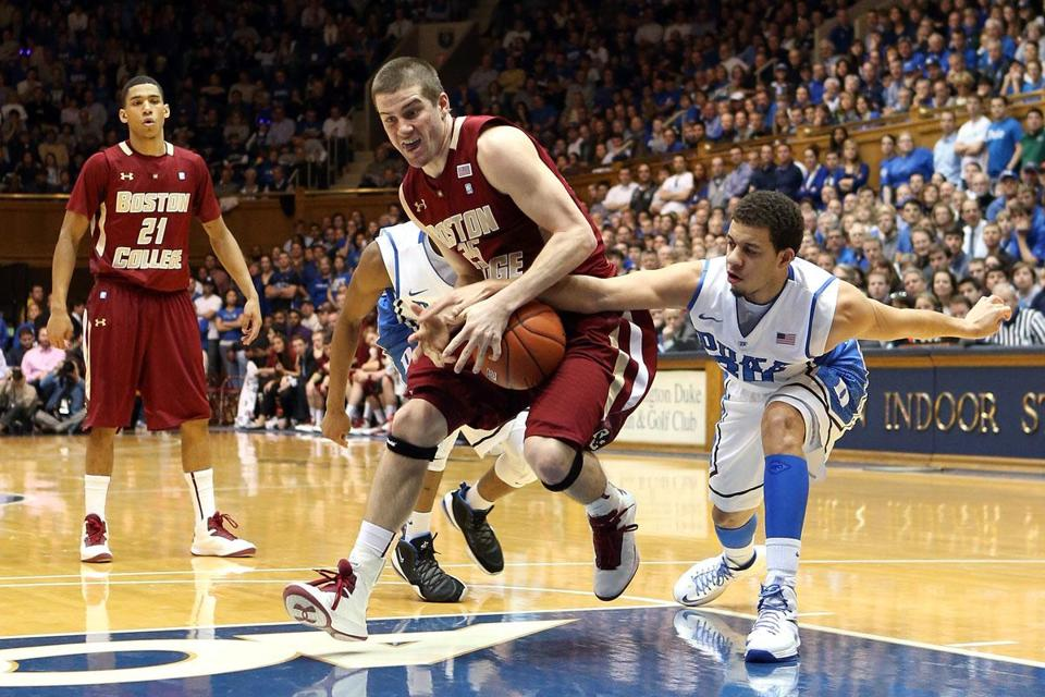 Duke's Seth Curry tries to steal the ball from BC's Joe Rahon, who struggled from the floor, going 1 for 5.