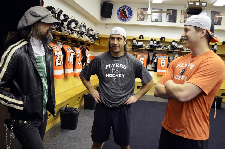 Rob Zombie (left) visited with Flyers players Maxime Talbot (center) and Claude Giroux in Philadelphia earlier this month.