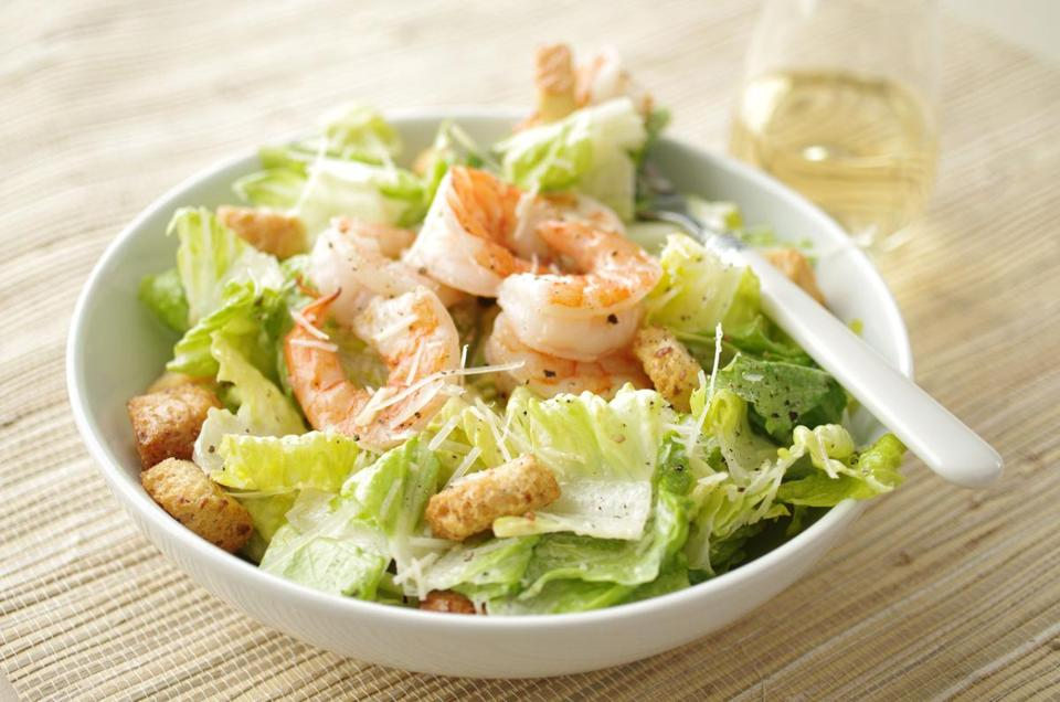 Caesar salad with broiled shrimp.