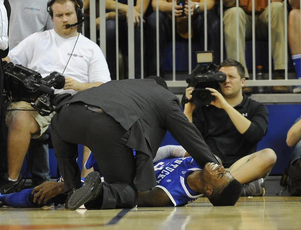 Kentucky forward Nerlens Noel grimmaced in pain after he injured his knee during a basketball game in February.