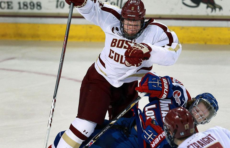 UMass-Lowell's A.J. White was sent to the ice by BC's Michael Matheson in the first period.