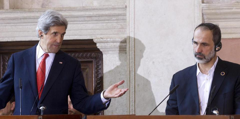 epa03604223 US Secretary of State, John Kerry (L) and Head of the National Coalition for Syrian Revolution and Opposition Forces, Ahmad Mouaz Al-Khatib (R), are seen during a press conference following a meeting in Rome, Italy, 28 February 2013. The newly appointed chief US diplomat is on a tour of Europe and the Middle East. On 27 February he said Washington was exploring ways to accelerate a political transition in Syria and that the opposition needed more help to overthrow President Bashar al-Assad. EPA/CLAUDIO PERI