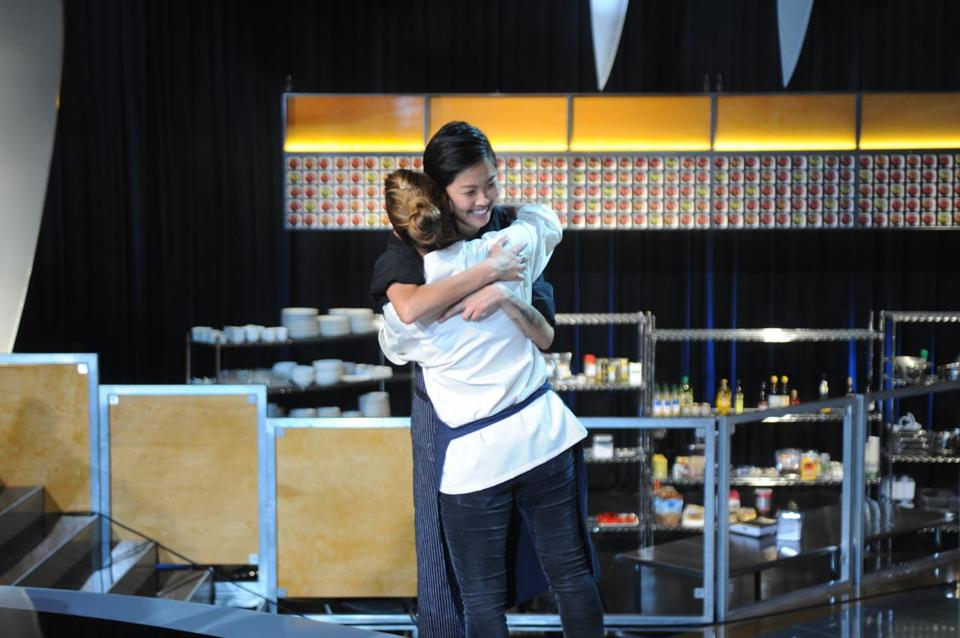 "Kristen Kish (facing) gets a hug after her victory on ""Top Chef."""