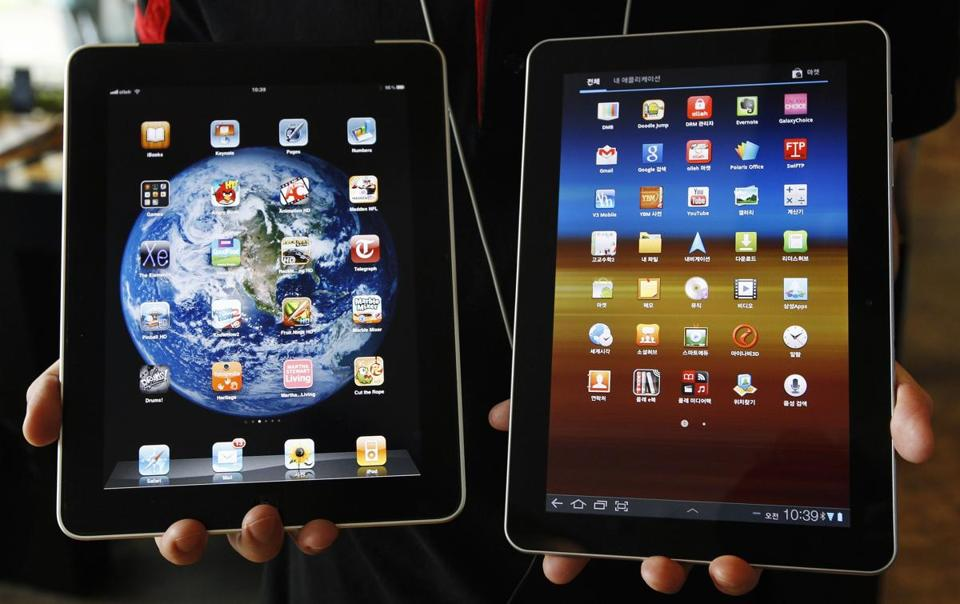 A jury had ordered Samsung, which makes the Galaxy tablet (right), to pay Apple, which makes the iPad (left), $1 billion.