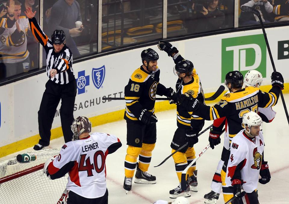 Nathan Horton celebrated his 2nd period goal with teammates David Krejci (center) and Dougie Hamilton as Senators goalie Robin Lehner turned his back.