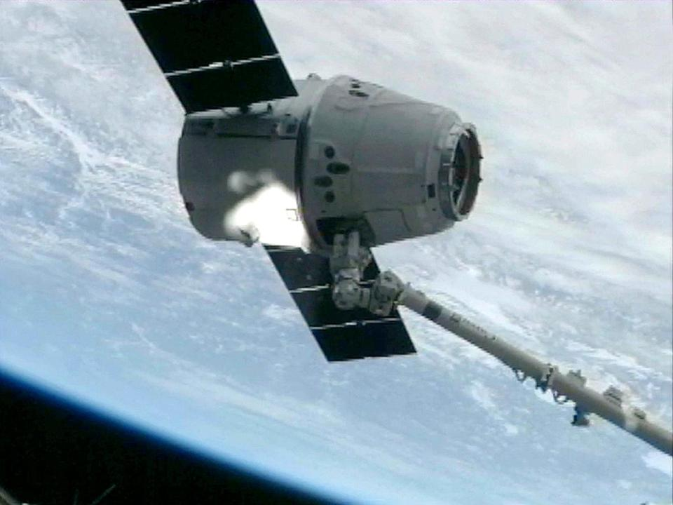 A NASA image shows the SpaceX capsule reaching the space station Sunday.