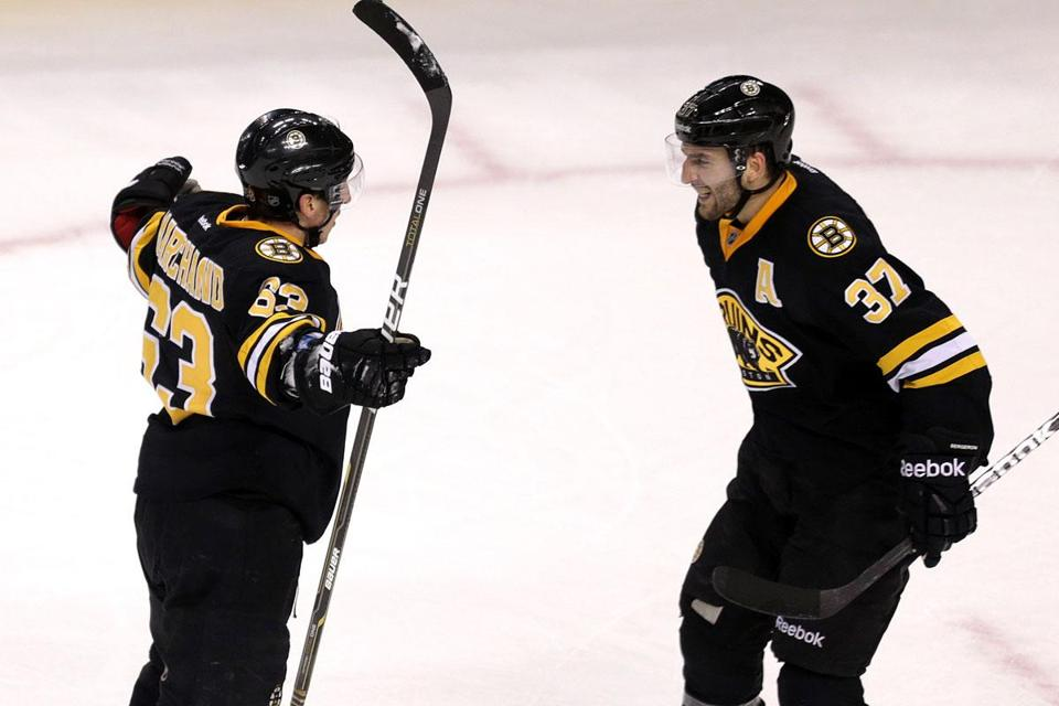 Brad Marchand (left) and Patrice Bergeron