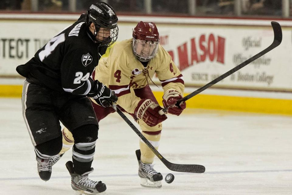 Noel Acciari, who got Providence on the board in the first, controls the puck in front of BC's Teddy Doherty.