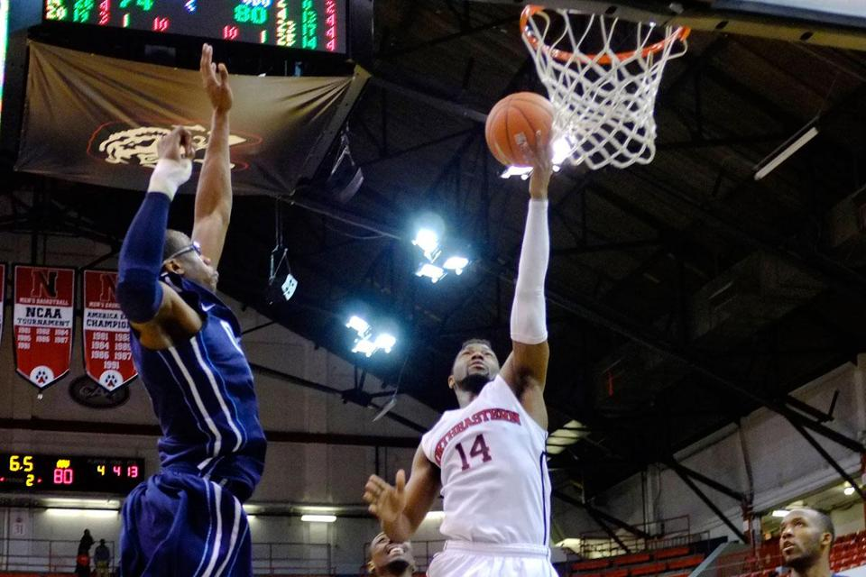 Northeastern's Jonathan Lee scores 2 of his game-high 26 points in his final home game.