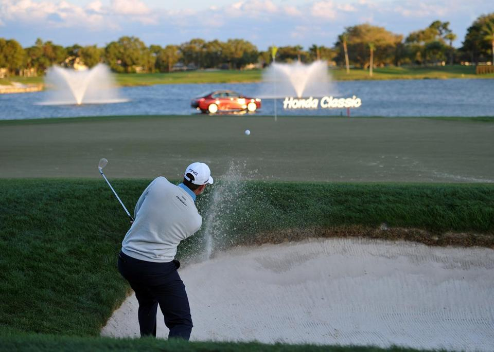 Facing a daunting bunker shot on No. 18, Michael Thompson cozied the ball up close to the hole and made his birdie.