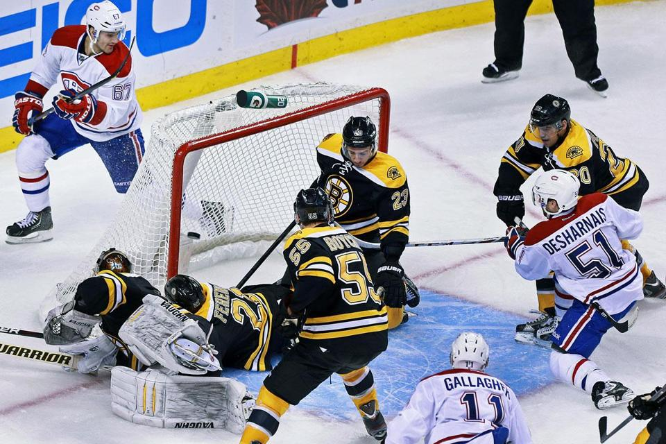 The Canadiens' David Desharnais beats down-and-out Bruins goalie Tuukka Rask after a free-for-all in front of the net to put Montreal ahead, 4-3.