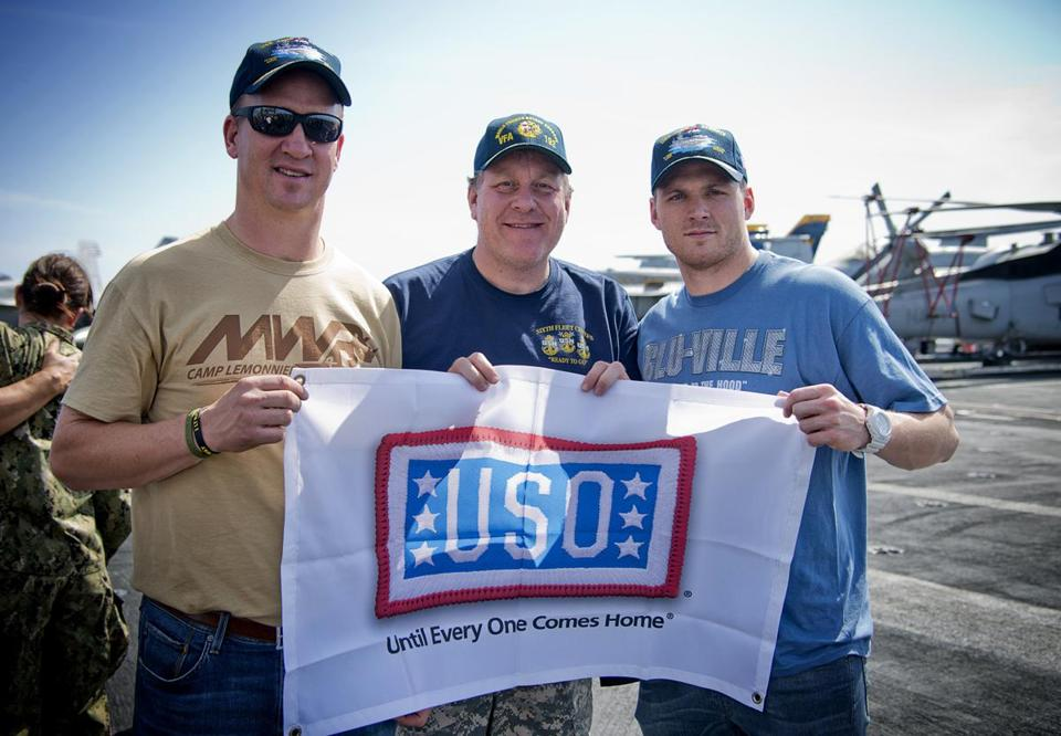 From left: Peyton Manning, Curt Schilling, and Austin Collie went overseas with the USO.
