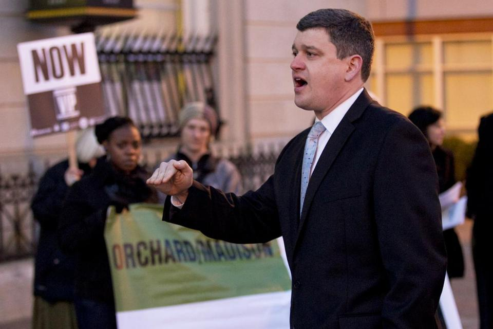 Boston City Councilor John Connolly speaks at a vigil Tuesday for a man fatally shot at Dudley Station in Roxbury.