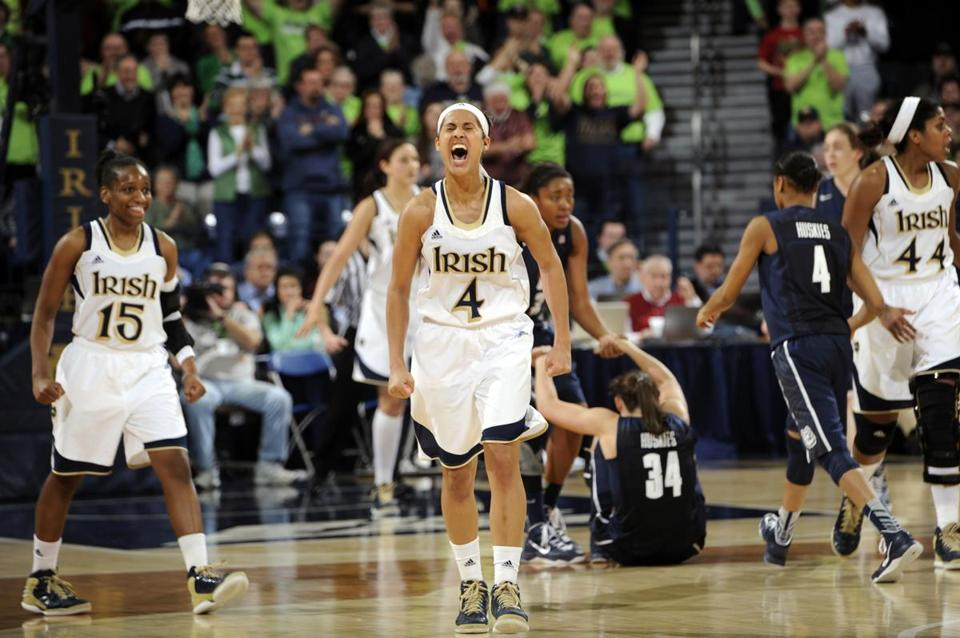 Notre Dame guard Skylar Diggins (4) celebrated a steal and the subsequent Connecticut foul during the third overtime of an NCAA college basketball game, Monday, March 4, 2013, in South Bend, Ind.