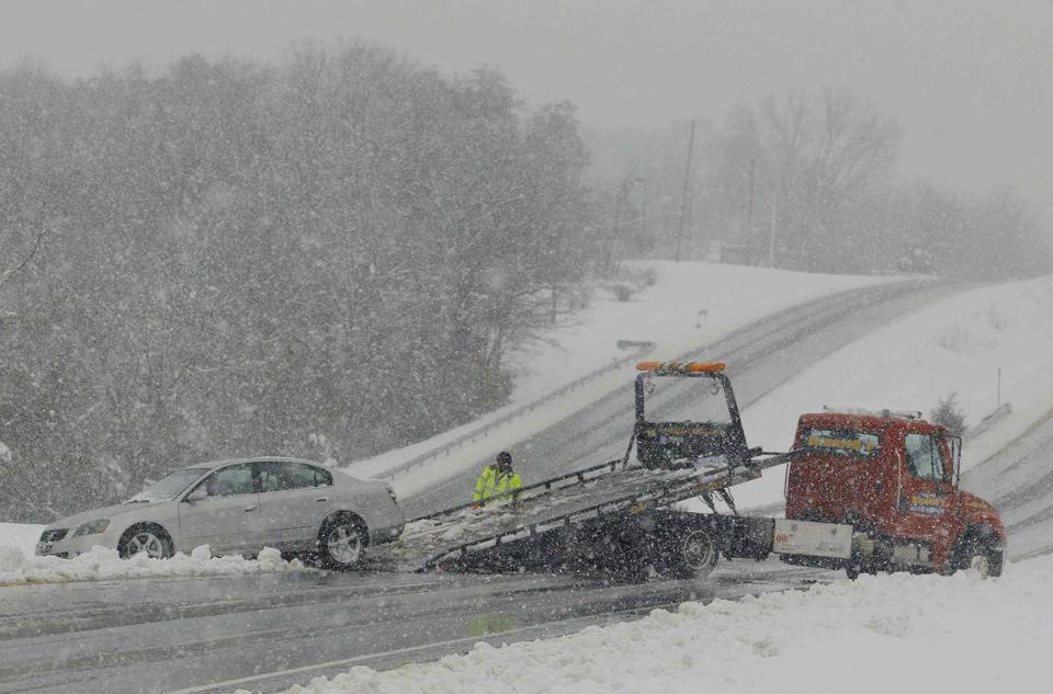 A car was towed from the median of Highway 50 near Winchester, Virginia, outside of Washington D.C., on Wednesday.