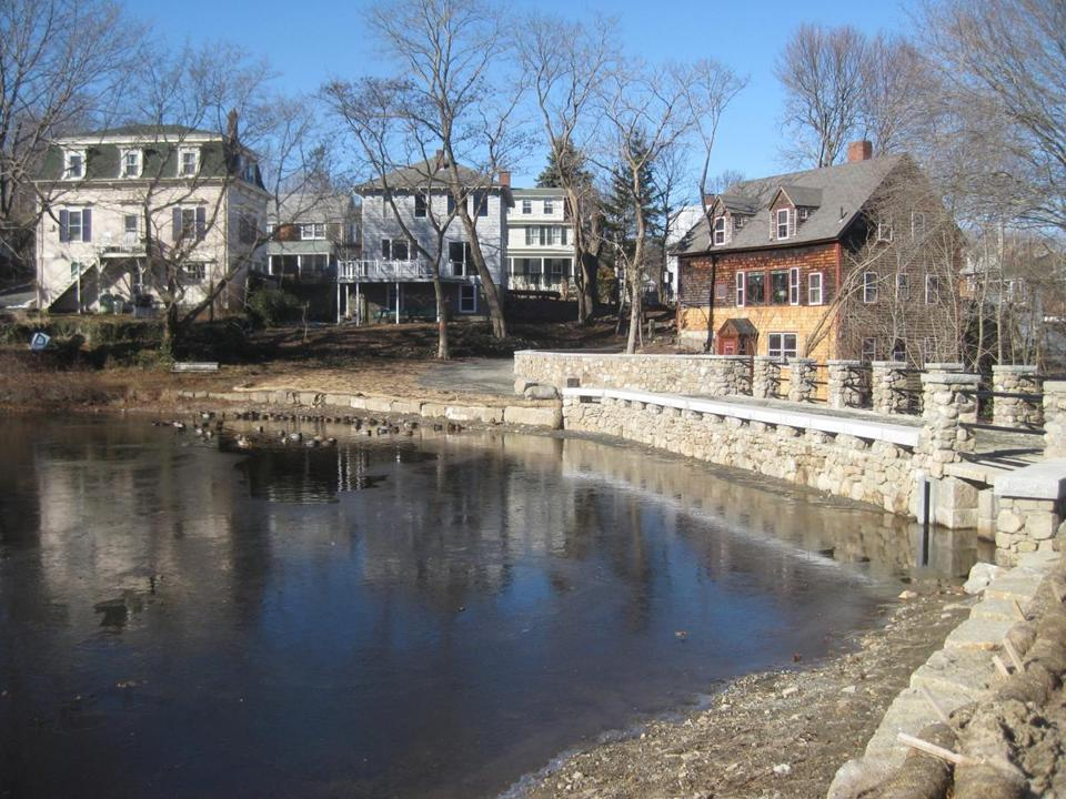 The rebuilt Mill Brook Dam in Rockport is made of concrete faced with granite from the earlier dam.