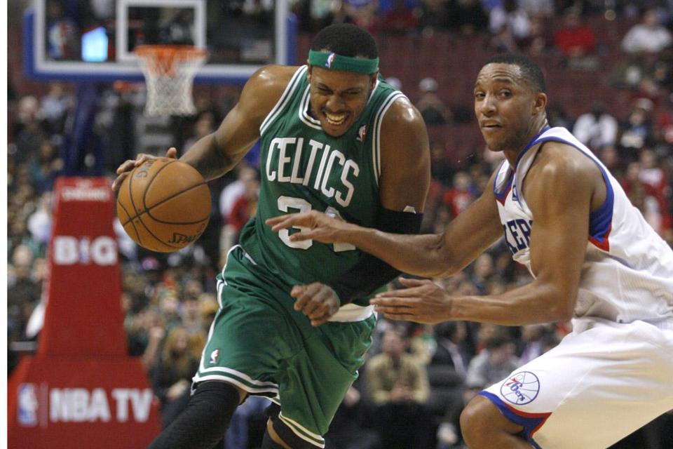 Paul Pierce drove against the 76ers' Evan Turner in the first half. Pierce finished with 18 points.