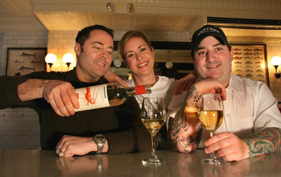 From left: Owners Jeff and Kelli Nace and former chef David Nevins of Neptune Oyster, named the top Boston restaurant in the 2014 Zagat survey. The current chef is Michael Serpa.