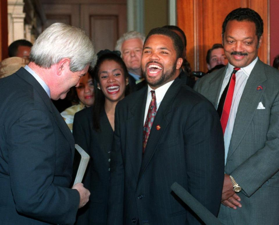 Jesse Jackson Jr. at his Capitol Hill swearing-in ceremony with his father, the Rev. Jesse Jackson.