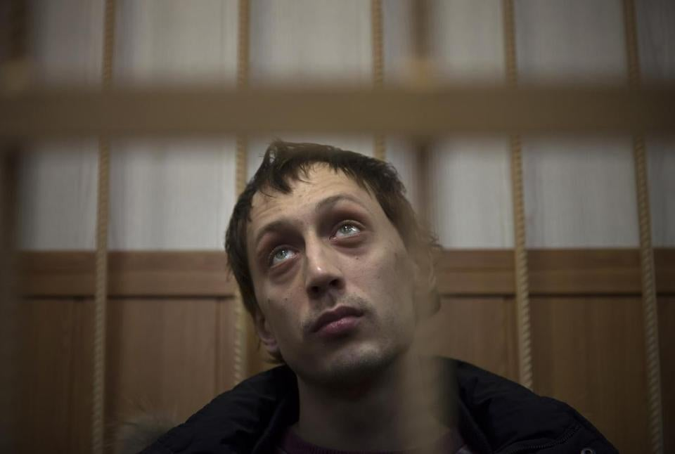 Bolshoi dancer Pavel Dmitrichenko, in a Moscow court Thursday, says he hired the men who attacked the ballet's director. He was reportedly upset that his girlfriend, a dancer, had been passed over for top roles.