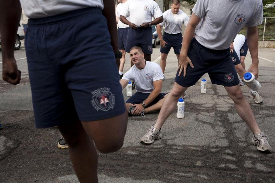 Boston Police recruits stretched out before their last workout at the Boston Police Academy before the June 2011 graduation.