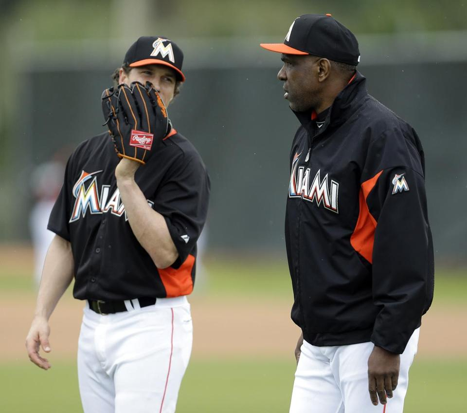 Andre Dawson, right, with Marlins left fielder Chris Coghlan, has joined Miami as a special adviser this spring.