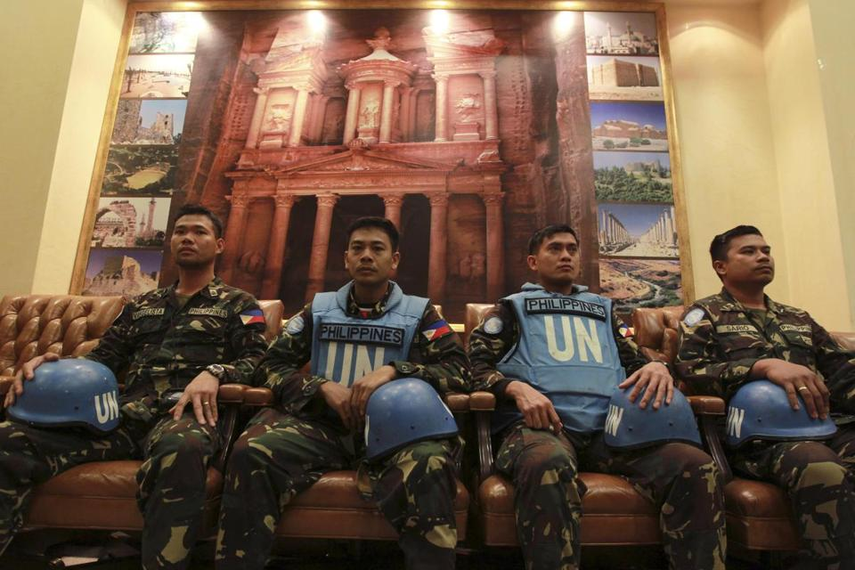 Some of the UN peacekeeping troops freed by Syrian rebels waited to address a news conference at the Jordanian army headquarters in Amman on Saturday.