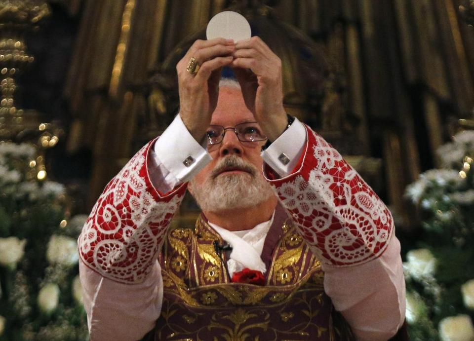 Boston Cardinal Sean O'Malley held the host while leading mass at the Santa Maria Della Vittoria church in Rome Sunday.
