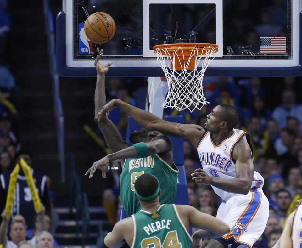 With Serge Ibaka (right) looming, this wasn't one of Kevin Garnett's best shots.